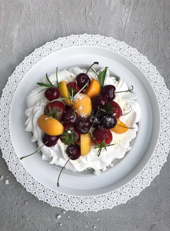 Delicious cake with meringue and berries on the table