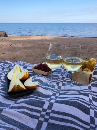 Wine, fruit and berries overlooking the river