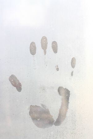 Handprints on the wet window close up Stock Photo