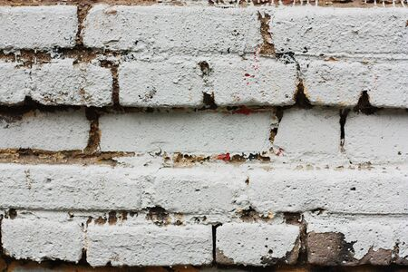 Old white brick wall of the house close up Stock Photo