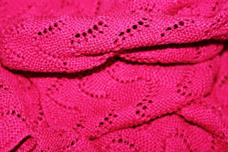 Beautiful knitted pink sweater close up view