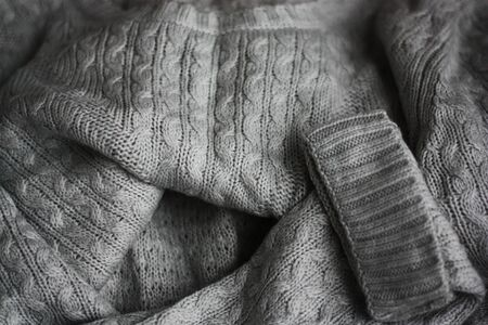 Beautiful knitted gray sweater close up view
