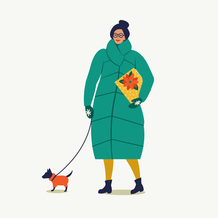 Lady walking with dog carry a Christmas box. Merry Christmas and Happy New Year. People are preparing for the new year. Banque d'images - 110885039