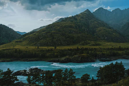 Summer landscape with mountains and river. Blue sky