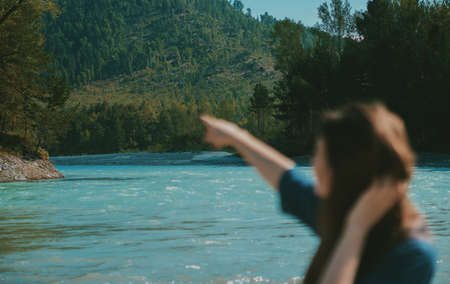 Summer landscape with mountains and river. woman in defocus