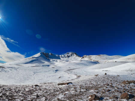 The summit of the sleeping volcano in Erciyas Turkey in winter. Sunny bright day in the mountains. Clear blue sky over the ski slope. 写真素材