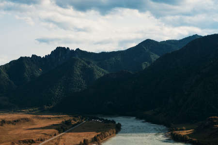 Beautiful landscape of forest mountains and flowing river. The Great Altai Mountains are the best place for recreation and tourism. Blue sky with clouds on a summer day. 写真素材 - 162878924