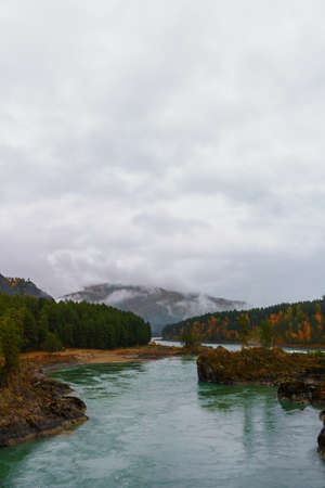 Beautiful autumn landscape of forest mountains in fog after rain. The Great Altai Mountains are the best place for recreation and tourism. The Katun River flows at the foot of the mountains. 写真素材 - 162878929