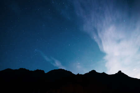 Starry sky over the mountains. Long exposure galaxy night shot.