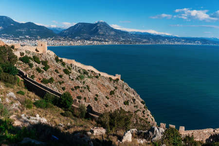 Top view of the wall, a fortress in Alanya over the sea. Beautiful landscape of mountains, sea, city and local attractions in Turkey. 写真素材 - 163555887