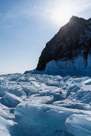 Splinters of broken ice on the Lake Baikal. Beautiful colored ice in Russia.