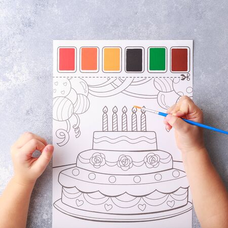 grey background, stationary, childrens hands color a picture, flat lay top view. art painting,
