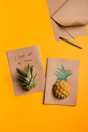 creative tropical greeting cards with pineapple and its crown