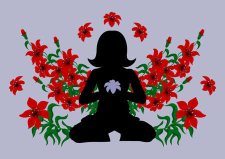 Silhouette of meditating woman surrounded with red lilies