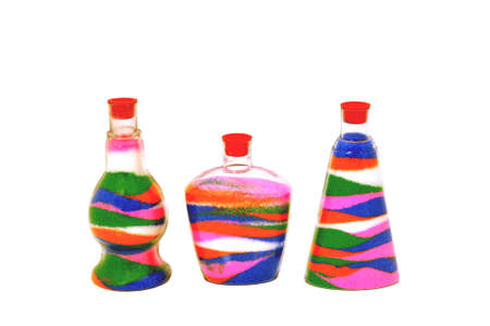 glasses in the sand: Colored sand poured in layers in a glass jar
