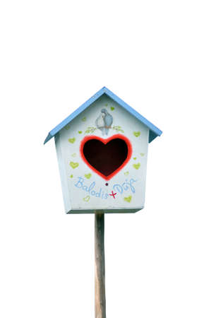 Bird house with entrance in the form of heart on a white background photo