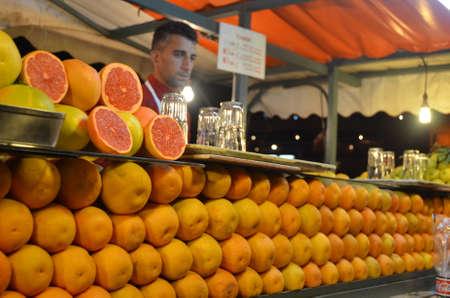 Marrakech, Morocco November 19, 2012. Orange juice vendor in the Jemaa el Fna square, Marrakech Editorial