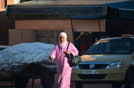 Marrakech, Morocco November 19, 2012. Woman with djellaba in the city of Marrakech.