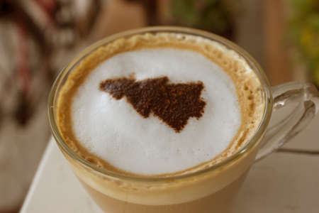 cup of hot coffee in latte style with Chritmas tree shape on the milk form Stock Photo