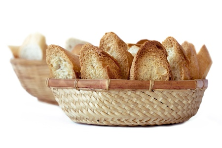 integral oven: two baskets of bread, a toast and the other with normal bread on white background