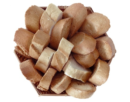 integral oven: a basket of bread with slices of toasted bread and regular bread on white background