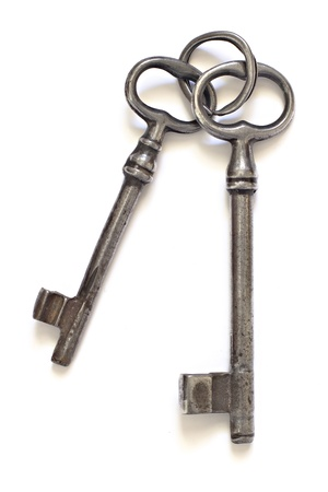 key ring: two old keys on an old key ring on a white background