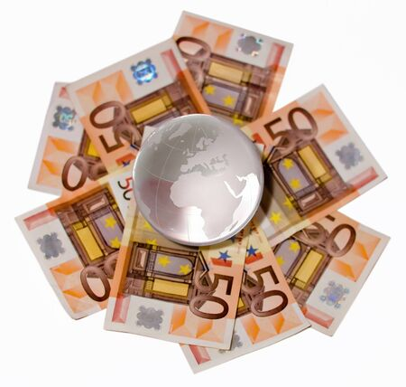Glass globe with a focus on Europe and Africa on a Euro bills on a white background photo
