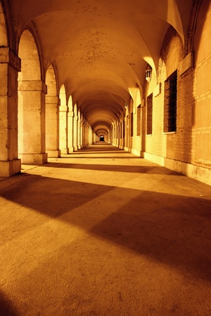 Arches of a portico at night