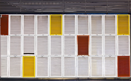 composition of multiple colors shutters in a building photo