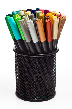 a selection of colored markers in a pencil holder photo