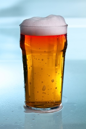 a delicious cold beer on a glass table Stock Photo - 11889924