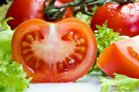 close-up of a tomato with lettuce for a salad