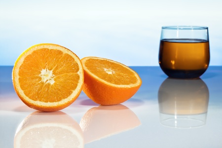 two slices of orange and a glass of juice photo