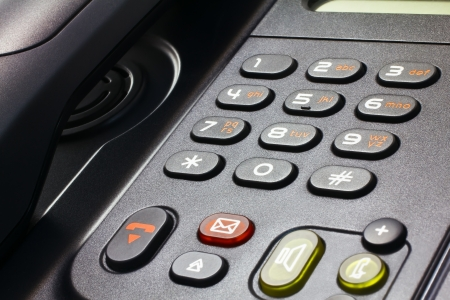 close-up of black desk telephone VoIP