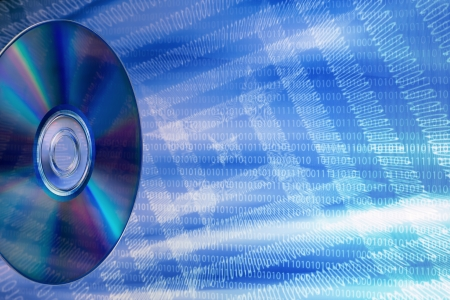 portable rom: DVD on an abstract background of binary numbers, simulating a data flow Stock Photo
