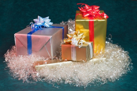 various Christmas gifts on a green background photo