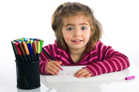 little finger: Child preschooler at the table draw with markers in white background  Stock Photo