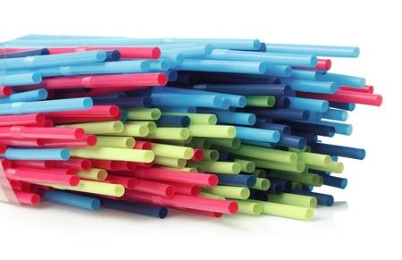 horizontal arrangement of straws isolated on white background photo
