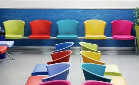 pediatrics: Chairs of various colors arranged in the classroom Stock Photo