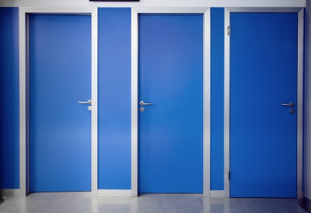 out of doors: Three doors closed of a consulting room of a hospital Stock Photo