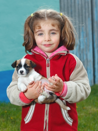 Portrait of a beautiful little girl with a cute puppy  photo