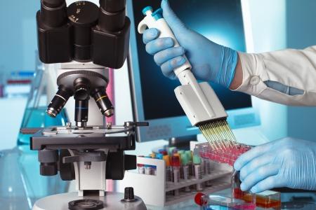 scientist depositing genetic samples in a plate