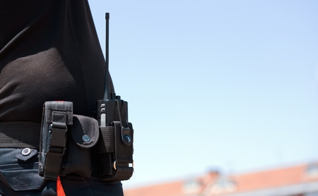 vigilant: radio equipment in the belt of a security guard