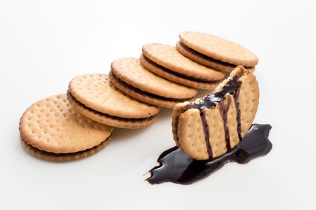 skewed: Close up of cookies   biscuits filled with chocolate on white background