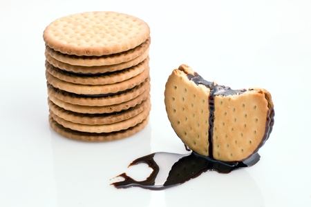 stacked cookies filled with a pouring chocolate photo