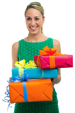 girl holding and offering christmas gifts in white background photo