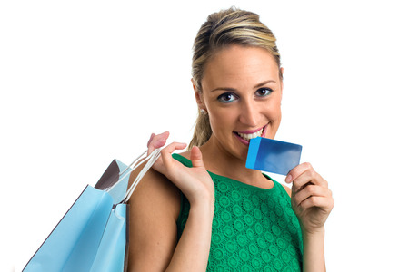 Young woman with shopping bags and credit card  photo