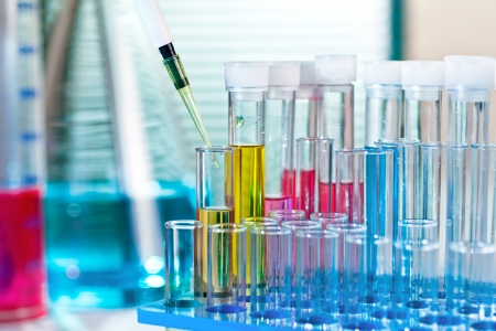 a table with glass material scientist in chemical lab Stock Photo