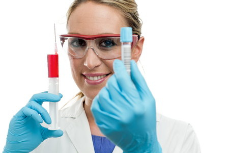 woman laboratory technician showing a tube of blood and syringe  photo