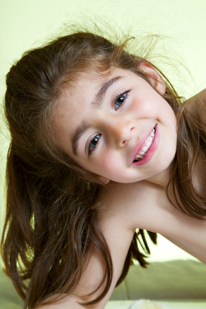 portrait Cute little girl lying in bed ready for bath Stock Photo - 27743682